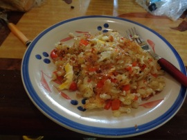 hash brown, eggs, tomato, and red pepper scramble